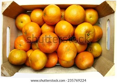 tangerine in wooden crate - stock photo