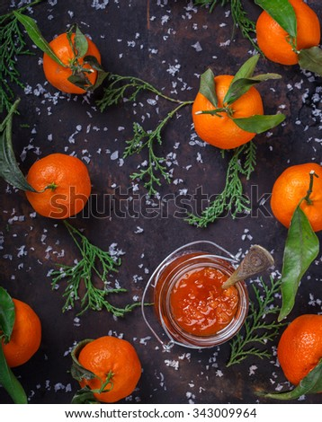 Tangerine jam in a glass jar.A traditional dessert at Christmas and New year. - stock photo
