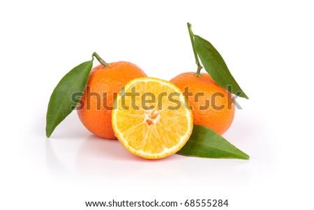Tangerine oranges and one sliced isolated on white background - stock photo