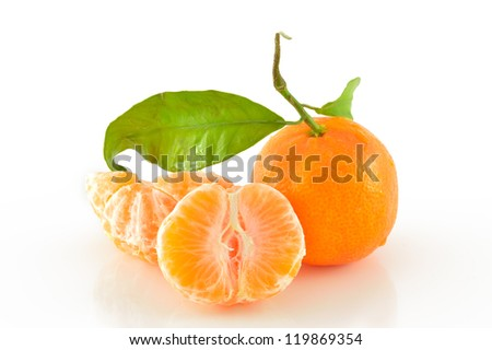 Tangerine slices on a white background close-up - stock photo