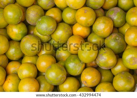 Tangerine, Thai orange ,Asian orange, Thai fruit, Thai traditional fruit. Fresh Oranges background,sweet green Thai orange for sale. - stock photo