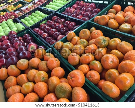 Tangerines and apples at market