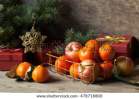 Tangerines and apples with Christmas gifts