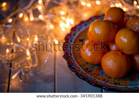 tangerines, Christmas card with bokeh light. Selective focus