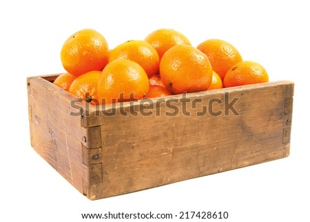Tangerines in an old box on a white background. - stock photo