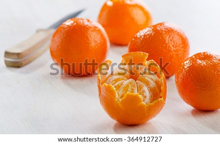 Tangerines on a wooden table. Selective focus