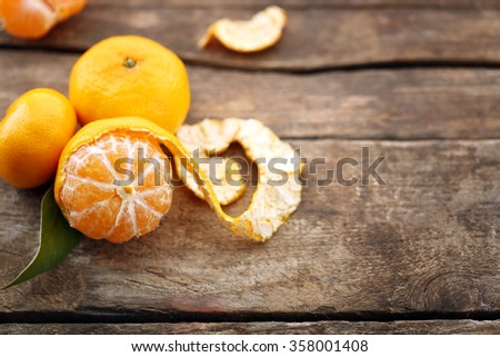 Tangerines on old wooden table, close up - stock photo