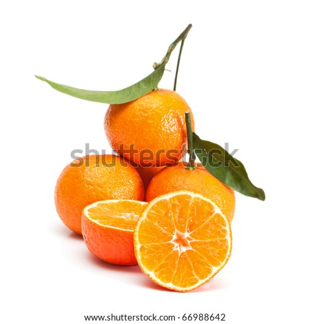 Tangerines with green leaves isolated on white. - stock photo