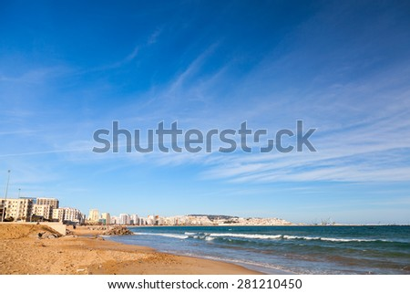 Tangier city and blue cloudy sky, coastal landscape, Morocco, Africa - stock photo