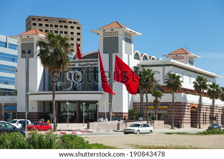 TANGIER, MOROCCO - MARCH 23, 2014: Central railroad station building facade with national flags