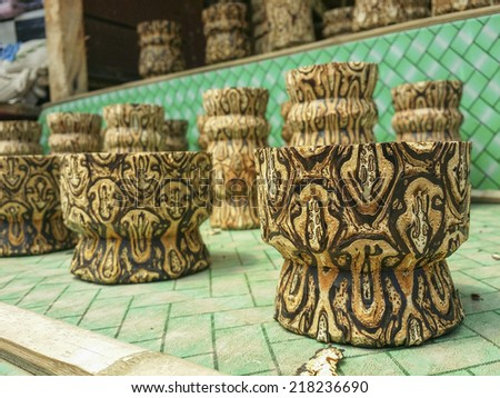 TANGKUBAN PERAHU, BANDUNG, WEST JAVA, INDONESIA - SEPTEMBER 15, 2014: Small wooden vases on sale in Tangkuban Perahu, Indonesia. These vases are made from special batik wood only grown in Indonesia. - stock photo