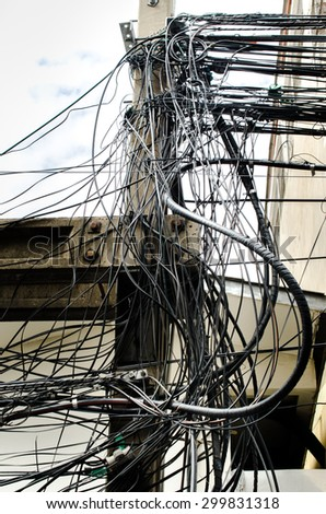 Tangle of Electrical Wires   Bangkok Thailand - stock photo
