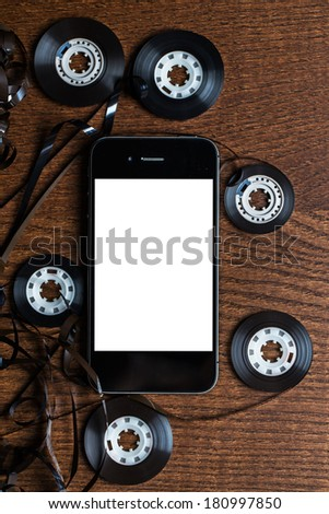 Tangled audio tape on the table - stock photo