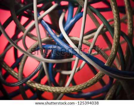 Tangled cables over red background