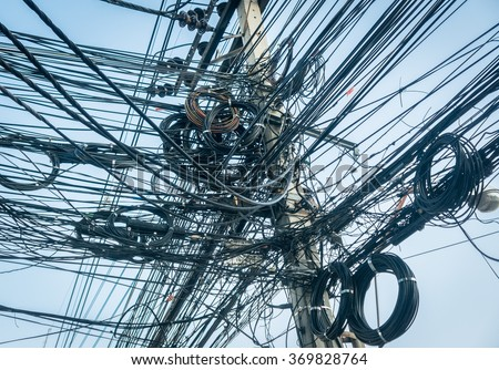 Tangled power lines very messy - stock photo