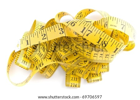 tangled up tape measure - stock photo