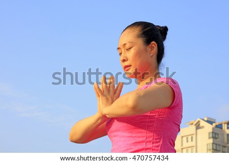 Tangshan - August 8: woman doing yoga exercise in the park, August 8, 2016, tangshan city, hebei province, China