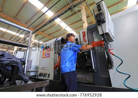 Tangshan City - August 26, 2017: workers in the production line, in a factory, Tangshan City, Hebei, China