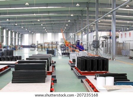 TANGSHAN CITY - MAY 29: Stainless steel enamel production line in a factory, on may 29, 2014, Tangshan city, Hebei Province, China