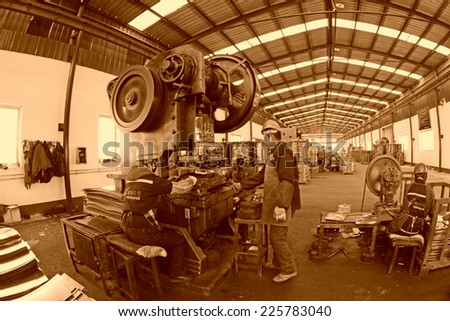 TANGSHAN - DECEMBER 20: Blanking workshop production line, in a manufacturing enterprise, on December 20, 2013, tangshan city, hebei province, China.