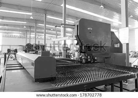 TANGSHAN - DECEMBER 22: Numerically-controlled machine tool in the production line, in a solar equipment production workshop on december 22, 2013, tangshan, china.