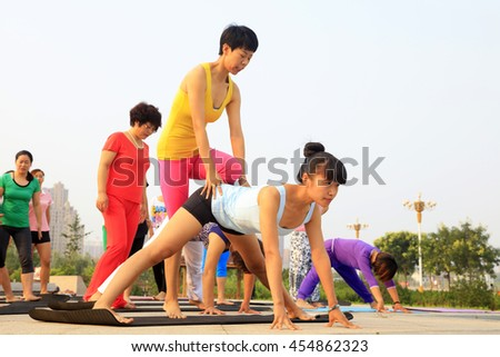 Tangshan - July 17: women doing yoga exercise in the park, July 17, 2016, tangshan city, hebei province, China