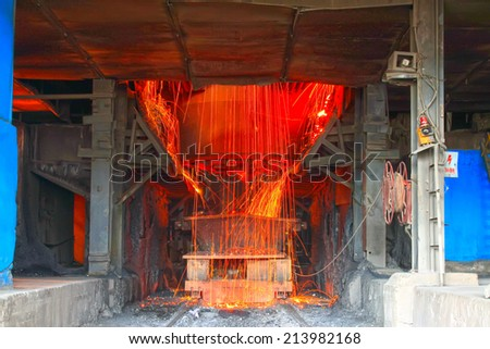 TANGSHAN - JUNE 20: converter dumping steel slag in iron and steel co., on June 20, 2014, Tangshan city, Hebei Province, China
