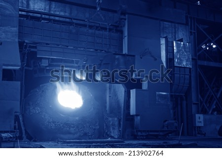 TANGSHAN - JUNE 18: converter plus iron material in iron and steel co., on June 18, 2014, Tangshan city, Hebei Province, China  - stock photo