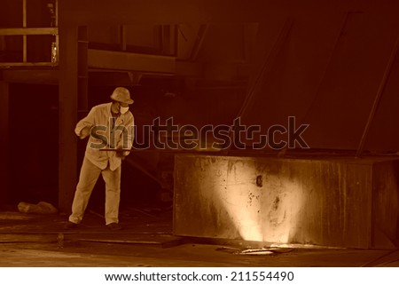 TANGSHAN - JUNE 19: iron works blast furnace operating workers, on June 19, 2014, Tangshan city, Hebei Province, China  - stock photo