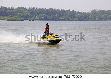 Tangshan - June 19, 2016: motorboat stunts on water, Tangshan City, Hebei, China