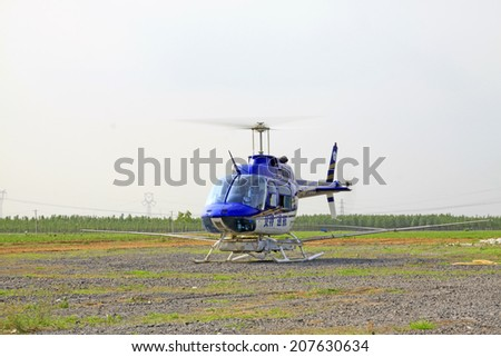 TANGSHAN - JUNE 13: spraying pesticide helicopter to start, on june 13, 2014, Tangshan city, Hebei Province, China