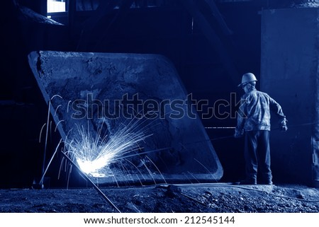 TANGSHAN - JUNE 19: worker repair mechanical parts in the production workshop, on June 19, 2014, Tangshan city, Hebei Province, China  - stock photo