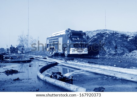 TANGSHAN - NOVEMBER 20: prepare to leave the scene of the fire fighting vehicles and personnel after the fire, November 20, 2013, tangshan city, hebei province, China.