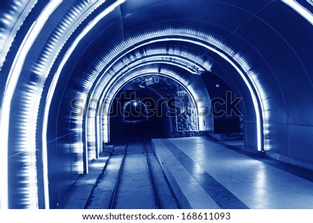 TANGSHAN - NOVEMBER 16: The underground tunnel rail in the kailuan national mine park, november 16, 2013, tangshan, hebei province, china.