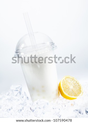 Tangy lemon boba tea with tapioca pearls in a covered glass chilled on ice - stock photo