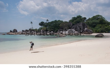 Tanjung Tinggi beach, Belitung island, Bangka-Belitung, Indonesia - August 30, 2007 : Photographer on Tanjung Tinggi beach
