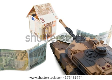 Tank crushes house built of euro banknotes isolated on white background - stock photo