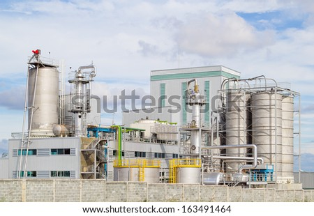 Tank of industrial process with blue sky background. - stock photo