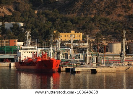 Tanker at the oil refinery industrial port - stock photo