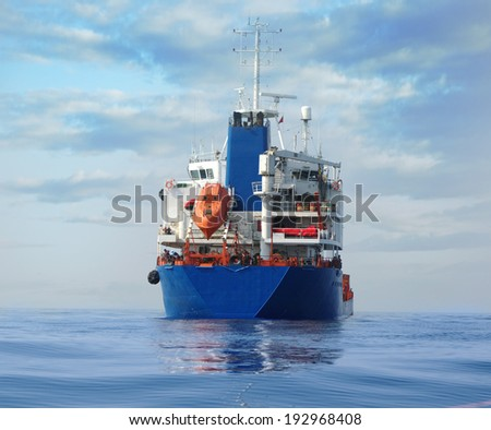Tanker blue loaded back view  in the ocean - stock photo
