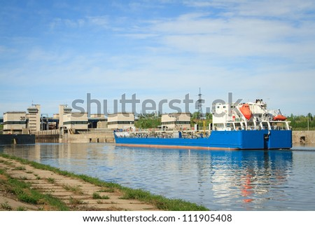 tanker in the channel comes into the gateway - stock photo