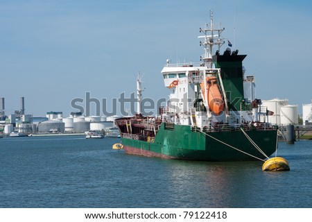 tanker moored at a yellow buoy in the rotterdam harbor