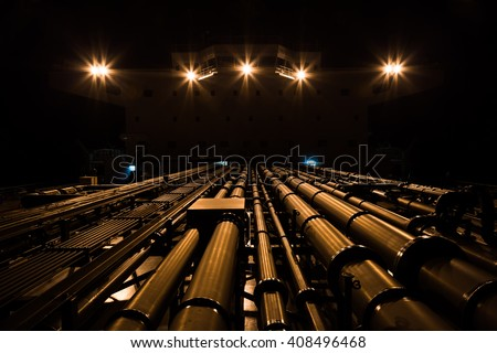 Tanker pipeline and superstructure at night. - stock photo