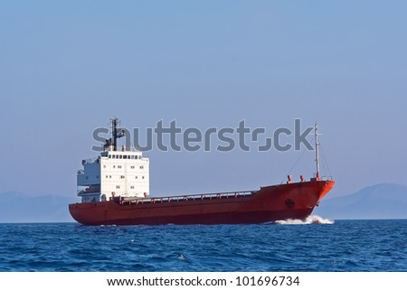 Tanker sailing in the blue sea - stock photo