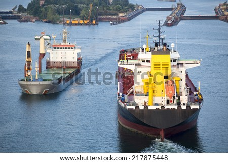 Tanker ship and freight ship on Kiel Canal, Germany - stock photo