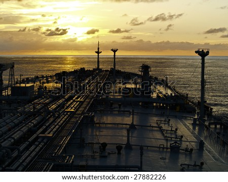 tanker ship on sunset - stock photo