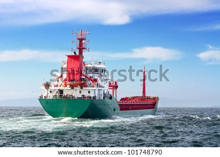 Tanker ship sailing in to the open sea - stock photo