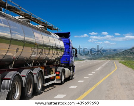 Tanker with chrome tanker on the highway. Working visit - stock photo
