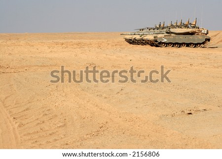 tanks in the desert - stock photo