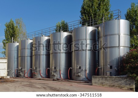 tanks with wine at the winery - stock photo